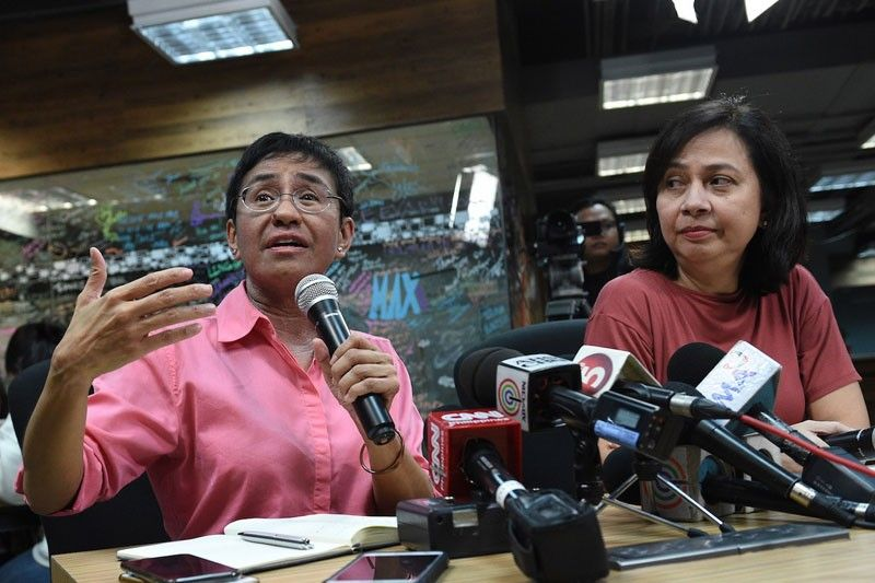 Rappler chief Maria Ressa and a former investigative reporteer were summoned by the National Bureau of Investigation over a complaint by a businessman for alleged violations of the country's Cybercrime Law. AFP/File