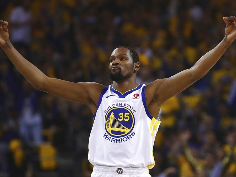 Durant, Green help Warriors knock Spurs out