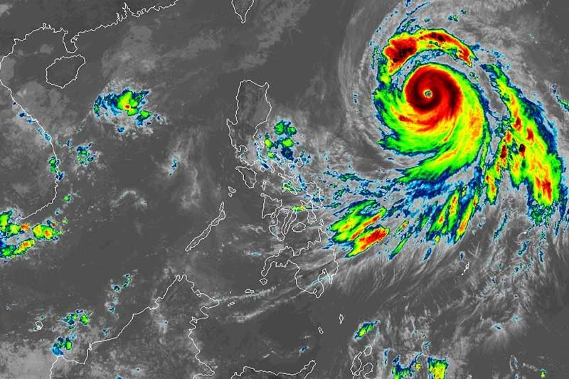 Typhoon Queenie speeds up, gains strength