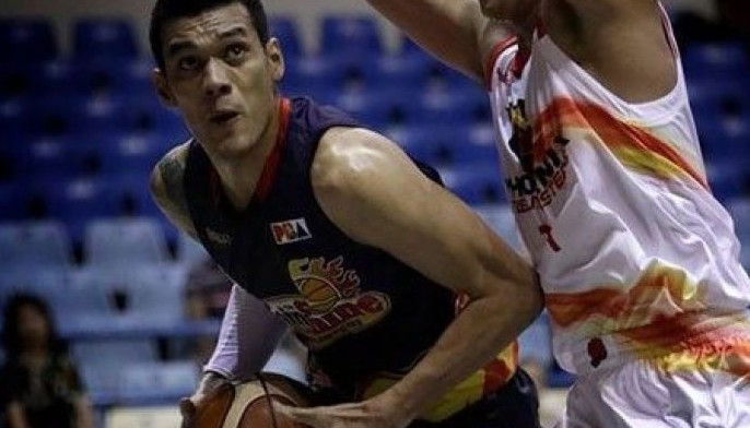 Raymond Almazan of Rain or Shine goes against a Phoenix defender in this undated photo.