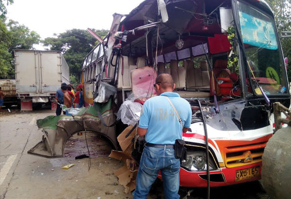 A traffic enforcer examines what is left of the bus involved in an accident in Magdugo, Toledo City. From the facebook account of Louie Trocio