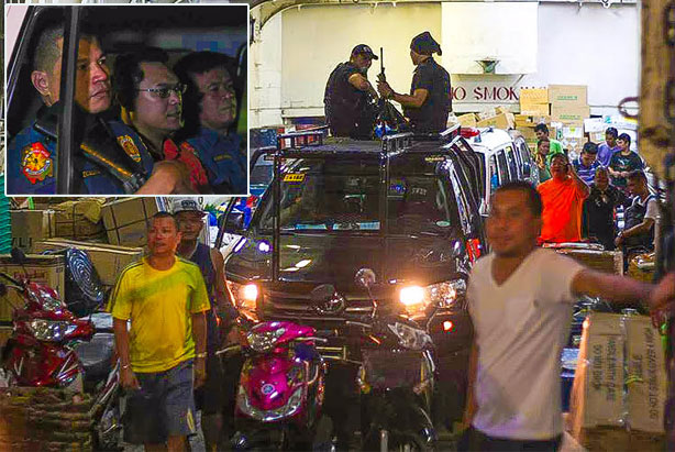 Police escort Bohol Board Member Niño Rey Boniel (inset) on board a vessel as he is being transported to the jail in Bohol from Cebu last night. Kristine Joyce W. Campaña