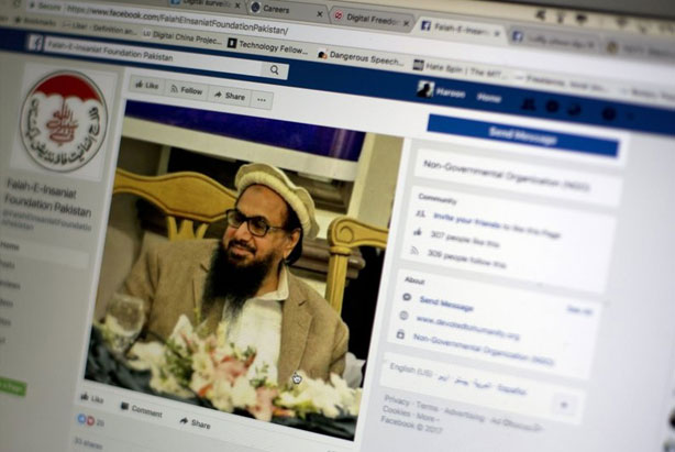 Photo, shows a Facebook site that features one of India's most wanted, Hafiz Saeed, the founder of Lashkar-e-Taiba, a banned organization and a U.S. declared terrorist group, in Islamabad, Pakistan. A senior Pakistani government official says more than 40 of 65 organizations banned in Pakistan operate flourishing social media sites, communicating on Facebook, Twitter, WhatsApp and Telegram to recruit, raise money and demand a rigid Islamic system. Meanwhile Pakistan is waging a cyber war against activists and journalists who use social media to criticize the government and its agencies. AP Photo/B.K. Bangash