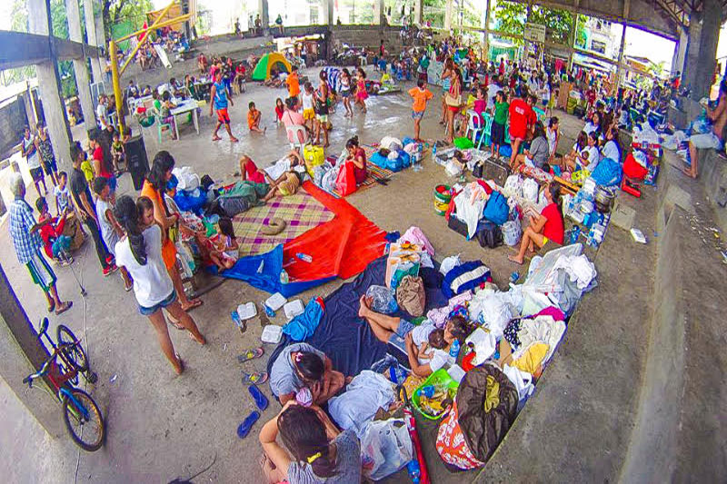 Survivors of the fire that hit Barangay Calamba, Cebu City last Monday afternoon take shelter at the barangay's sports complex. At least 309 families lost their homes to the fire. Paul Jun E. Rosaroso
