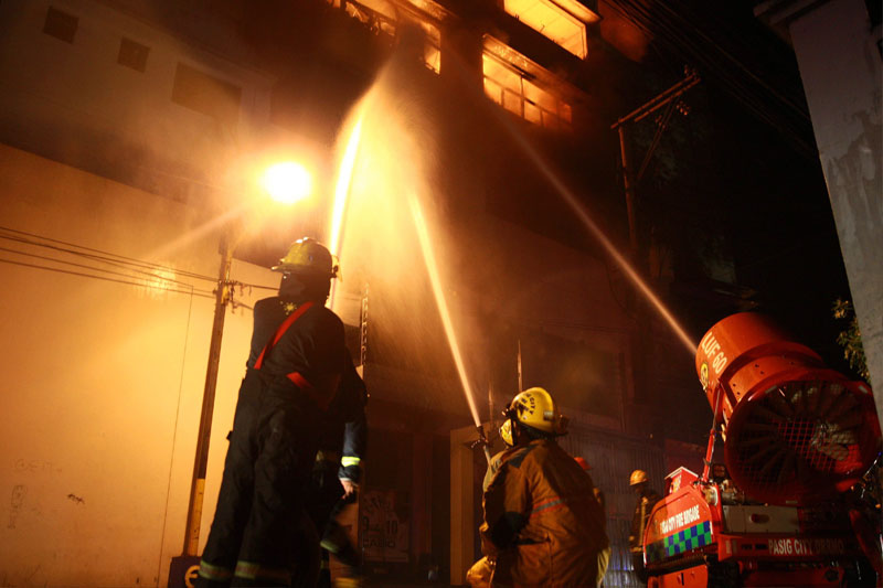 Firefighters train their hoses on the fire that broke out in Mario's Arcadia building Monday night. Joven Cagande
