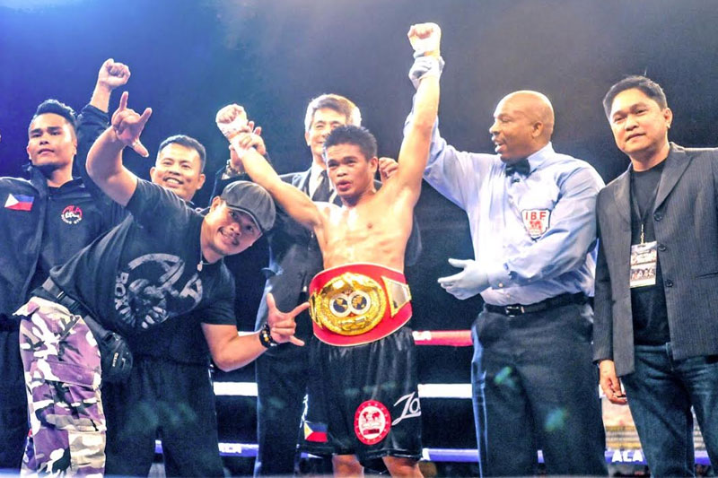 Jonas 'Zorro' Sultan of the ALA Boxing Gym raises his hands in jubilation after winning by unanimous decision over the heavily favored two-division world champion Johriel 'Quadro Alas' Casimero in their IBF junior bantamweight title eliminator last Saturday at the Waterfront-Cebu City Hotel & Casino. Paul Jun E. Rosaroso