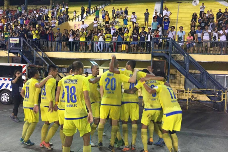 The Global Cebu FC booters celebrate after beating Ilocos United FC, 3-2, in the Philippines Football League last Sunday night at the Cebu City Sports Center. Paul Jun E. Rosaroso