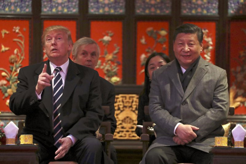 President Donald Trump, left, and Chinese President Xi Jinping, right, arrive for opera performance at the Forbidden City, Wednesday, Nov. 8, 2017, in Beijing, China. Trump is on a five country trip through Asia traveling to Japan, South Korea, China, Vietnam and the Philippines. AP/Andrew Harnik