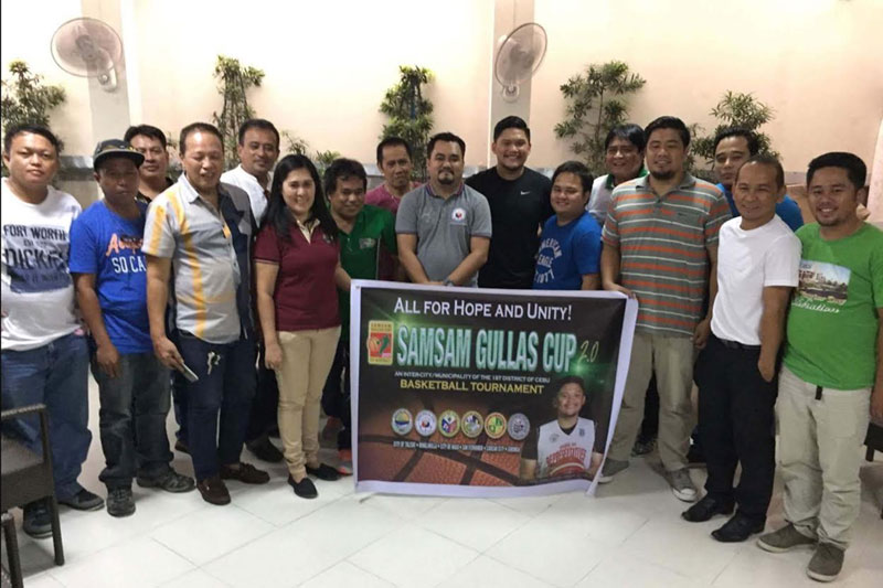 Cebu First District Rep. Gerald Anthony 'Samsam' Gullas (seventh from right) and Talisay City Councilor Rodi Cabigas (fifth from right) pose with team representatives during a press conference to publicize the 2nd Samsam Gullas Cup Inter-Cities and Municipalities Under-20 Developmental Basketball Tournament set to kick off this Saturday at the Minglanilla Sports Complex. Paul Jun E. Rosaroso
