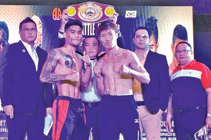 WBO International featherweight champion Mark 'Magnifico' Magsayo (second from left) and his Japanese challenger Shota Hayashi pose during the official weigh-on of 'Pinoy Pride 43:Battle in Bohol' yesterday at the Island City Mall in Tagbilaran City. They are joined by WBO fight supervisor Leon Panoncillo (left) and ALA Promotions President Michael Aldeguer (second from right). Paul Jun E. Rosaroso