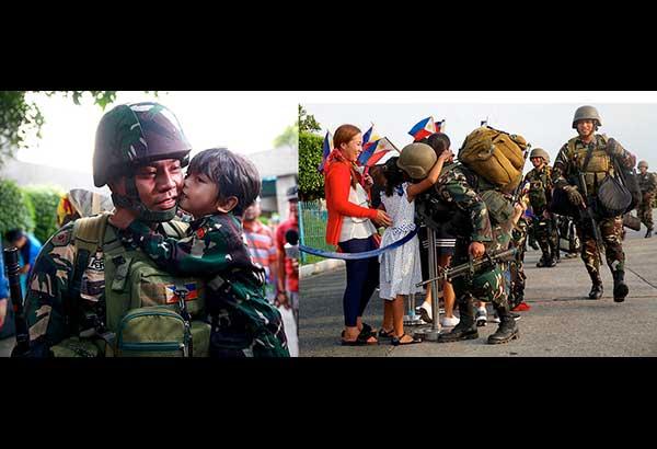 Isang matamis na halik at yakap mula sa kanilang mga anak ang sumalubong sa mga sundalo ng 1st Infantry Battalion ng 2nd Infantry Division ng Philippine Army nang dumating kahapon sa Villamor Airbase mula sa halos limang buwang pakikipaglaban sa Maute-ISIS terrorists sa Marawi City. (Bernard Testa/News5/InterAksyon.com)