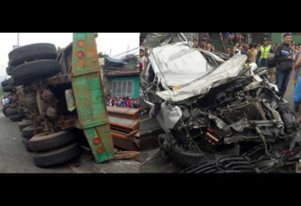 Ang 22-wheeler truck na umararo sa mga bystanders at mga sasakyan sa IBP Road sa QC. Makikita ang isang sasakyan na napipi ng 'nagwalang' trak.