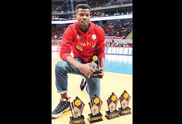 Allwell Oraeme with his collection of awards from the NCAA Season 91. File Photo