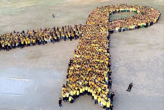 In this Feb. 17, 2014 photo, the EDSA People Power Commission in Cavite commemorates the 28th anniversary of the EDSA People Power Revolutionby gathering 3000 participants to form a human yellow ribbon. File photo