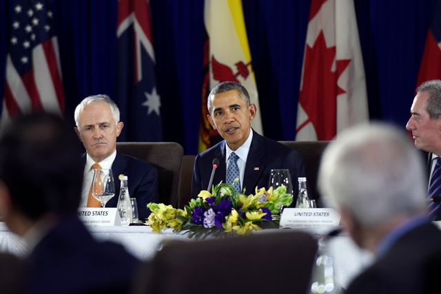 President Barack Obama, center, sitting next to Australia's Prime Minister Malcolm Turnbull, left, and U.S. Trade Representative Michael Froman, right, speaks during a meeting with other leaders of the Trans-Pacific Partnership countries in Manila, Philippines, Wednesday, Nov. 18, 2015, ahead of the start of the Asia-Pacific Economic Cooperation (APEC) summit. AP/Susan Walsh
