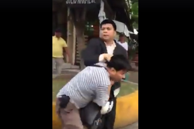 In this video screengrab, a civilian can be seen arresting expelled Iglesia Ni Cristo minister Lowell Menorca. Facebook/Ang Tamang Daan Contradiction Teachings