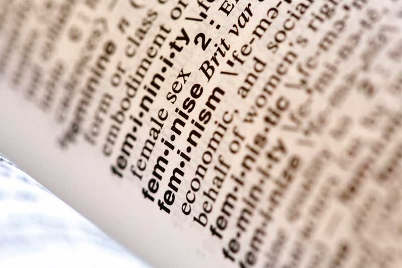 """This Monday, Dec. 11, 2017, photo taken in New York shows the word feminism listed in the dictionary. Merriam-Webster has revealed """"feminism"""" as its word of the year for 2017 on Tuesday, Dec. 12. AP/Peter Morgan"""