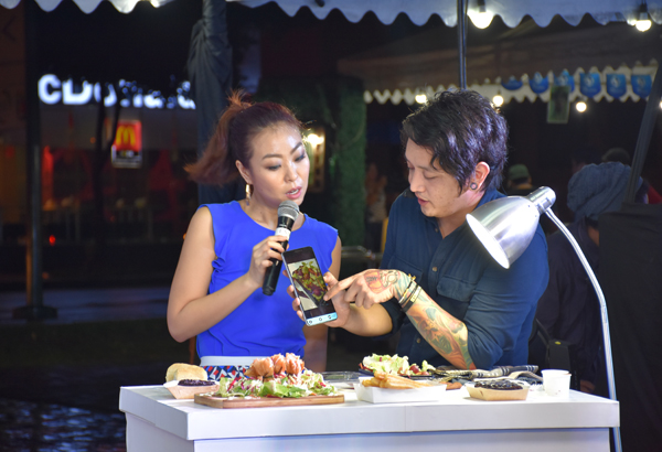 Food photographer Adrian Agulto and host Sam Oh in a food styling and photography workshop hosted by Globe myBusiness at MercatoCentrale, Bonifacio Global City Globe Telecom/Released