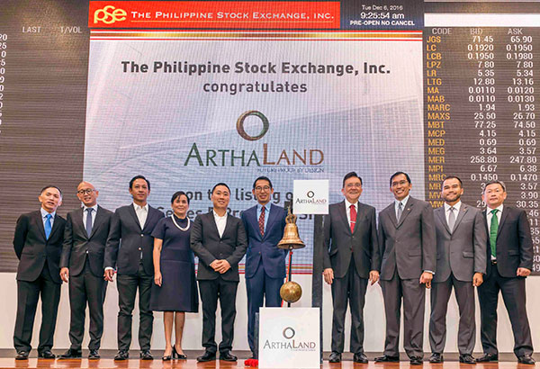 ARTHALAND LISTS PREFERRED SHARES: Officers from ArthaLand and the Philippine Stock Exchange pose before ringing the opening bell yesterday. In photo are (from left) BDO Capital president Ed Francisco, Arthaland officials Chris Po (director), Ricardo Po Jr. (vice chairman), Angela de Villa-Lacson (president and CEO), Enrique Gonzalez (director) and Leo Po (treasurer), and PSE's Jose T. Pardo (chairman), Hans Sicat (president), Roel Refran (COO) and Alejandro Yu (director).