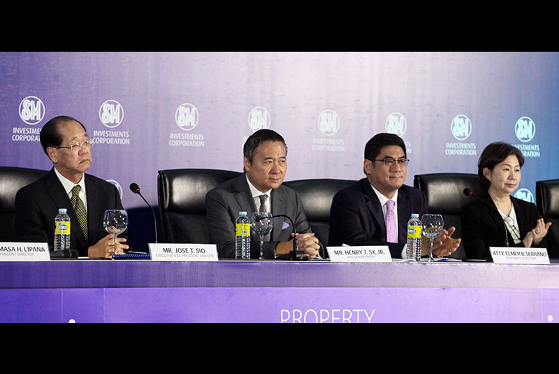 SMIC Annual Stockholders Meeting: SM Investments Corp. officials listen to queries from shareholders during the company's annual stockholders meeting held yesterday at the SMX Convention Center, Mall of Asia Complex in Pasay City. In photo are (from left) executive vice president and chief finance officer Jose Sio, vice chairperson Henry T. Sy, corporate secretary Elmer Serrano and vice chairperson Teresita Sy-Coson. MIKE AMOROSO
