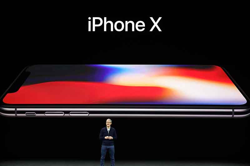 Apple CEO Tim Cook announces the new iPhone X at the Steve Jobs Theater on the new Apple campus, Tuesday, Sept. 12, 2017, in Cupertino, Calif. AP/Marcio Jose Sanchez