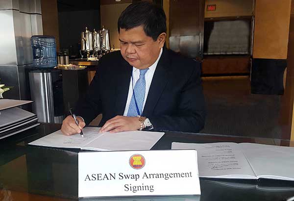 BSP Governor Nestor Espenilla signs the 6th supplemental MOU renewing the $2-B short-term forex liquidity support fund.