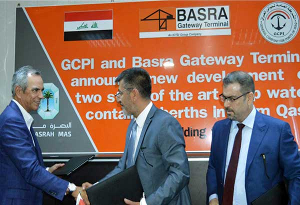 ICTSI chairman and president Enrique Razon Jr. (left) shakes hands with GCPI director Chief Riyadh after signing the expansion agreement. Looking on is Basra Mas CEO Ali Kh. Khalaf.
