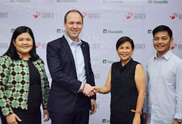 Manulife Philippines chief marketing officer Melissa Henson (from left) together with president and CEO Ryan Charland led the signing of the contract together with Hands on Manila president Gianna Montinola and executive director Emmanuel Marquez Jr.