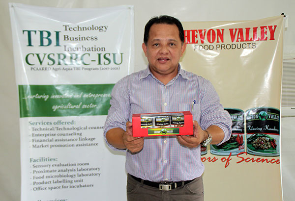Professor Jonathan Nayga proudly displays the canned goat products made by his team of researchers at Isabela State University during National Inventors Week held last month in Isabela province.