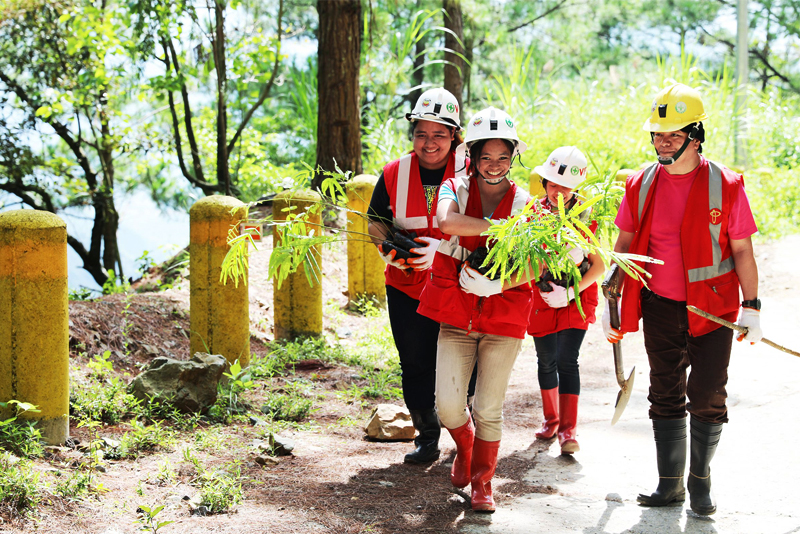 On the way to tree planting: Philex employees doing their share in environmental protection.