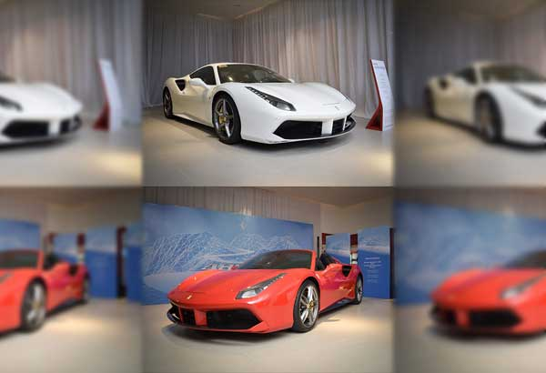 The magnificent Ferrari 488 Spider with the retractable hard top raised (white car) and lowered (red car)