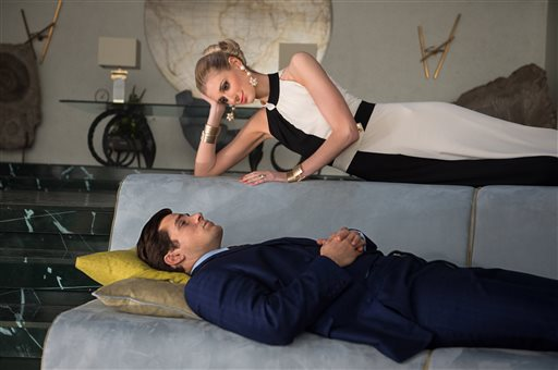 """Henry Cavill, as Napoleon Soto, and Elizabeth Debicki as Victoria in Warner Bros. Pictures' action adventure """"The Man from U.N.C.L.E.,"""" a Warner Bros. Pictures release. The movie opens Aug. 14. Daniel Smith/Warner Bros. Pictures via AP"""