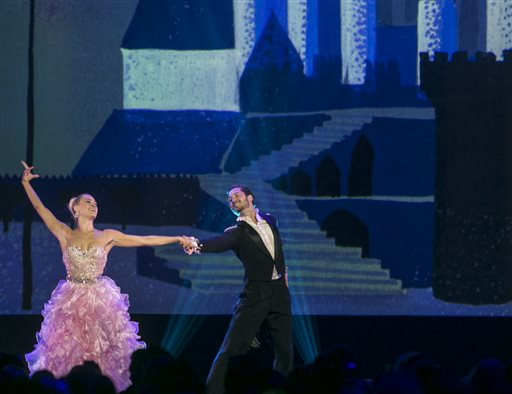Dancers Peta Murgatroy and Valentin Chmerkovskiy perform at Disney's D23 Expo, a fan convention in Anaheim, Calif., on Friday, Aug. 14, 2015. The Walt Disney Company honors those who have made significant contributions to the Disney legacy by naming them Disney Legends. AP Photo/Damian Dovarganes