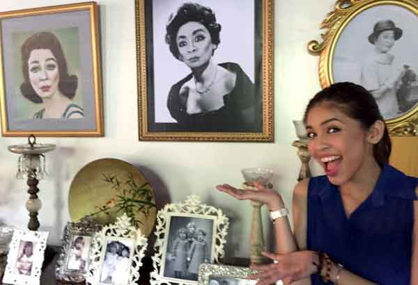 Top and below: Maine Mendoza poses with a blown-up picture of Wally Bayola as Lola Nidora at a big house in New Manila, Quezon City, that served as the 'mansion' of Lola Nidora for the date of Maine and Alden Richards