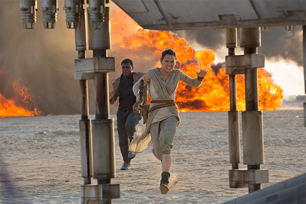 "Daisy Ridley, right, as Rey, and John Boyega as Finn, in a scene from the film, ""Star Wars: The Force Awakens,"" directed by J.J. Abrams. The movie opens in US theaters on Dec. 18, 2015. David James/Disney/Lucasfilm via AP"