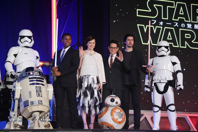 "In this Thursday, Dec. 10, 2015 file photo, director J.J. Abrams, third right, and actors, John Boyega, second left, Daisy Ridley, third left, and Adam Driver, second right, pose for photos during the Japan Premiere of their latest film ""Star Wars: The Force Awakens"" in Tokyo. AP/Koji Sasahara, File"