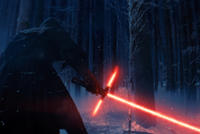 "This photo provided by Disney shows, Adam Driver as Kylo Ren with his Lightsaber in a scene from the new film, ""Star Wars: The Force Awakens."" Film Frame/Disney/Copyright Lucasfilm 2015 via AP"
