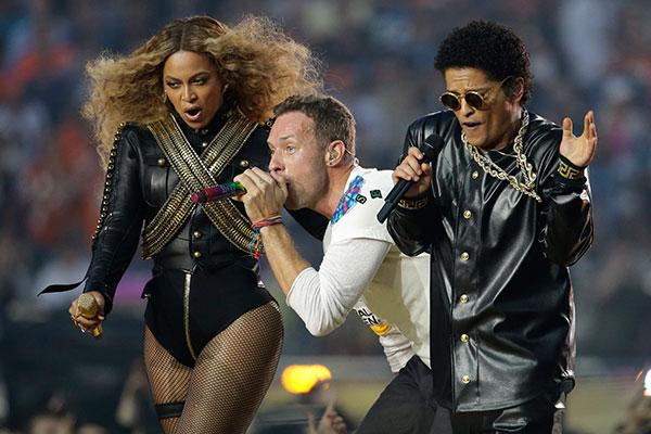 Beyoncé, Coldplay singer Chris Martin and Bruno Mars perform during halftime of the NFL Super Bowl 50 football game Sunday, Feb. 7, 2016, in Santa Clara, Calif. AP/Julio Cortez