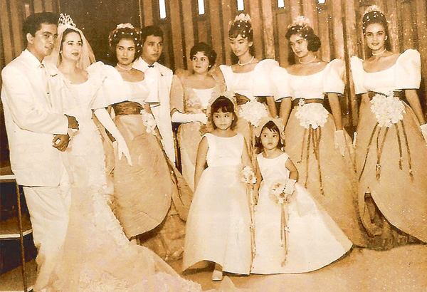 Juancho and Gloria with (from left) Daisy Romualdez, Tito Galla, Louise Galla, Barbara Perez, Susan Roces, Amalia Fuentes. Two cute flower girls are not identified.