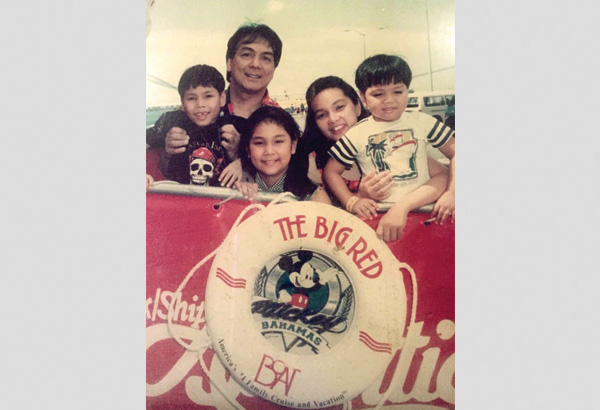 Isang lumang larawan mula 1994. That's me and Eileen with little Jako, Jocas and Jio on board the Big Red Boat.