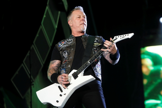 "FILE - In this May 9, 2015 file photo, James Hetfield of Metallica performs at Rock in Rio USA in Las Vegas. The band announced Thursday its releasing its first album in eight years. ""Hardwired ... To Self-Destruct"" will feature 80 minutes of music from the veteran heavy metal group. The album is scheduled for release Nov. 18. Photo by John Davisson/Invision/AP, File"