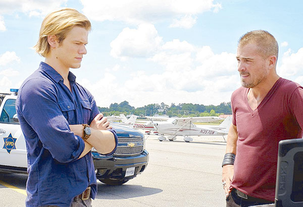 Lucas Till (left) and George Eads in a scene from MacGyver.