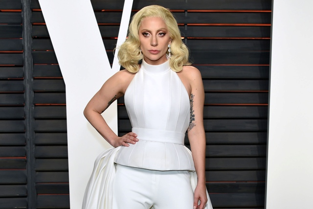 FILE - In this Feb. 28, 2016 file photo, Lady Gaga arrives at the Vanity Fair Oscar Party in Beverly Hills, Calif. Lady Gaga will be featured on Volume, a new SiriusXM talk channel devoted to music, debuting on Oct. 17. Photo by Evan Agostini/Invision/AP, File