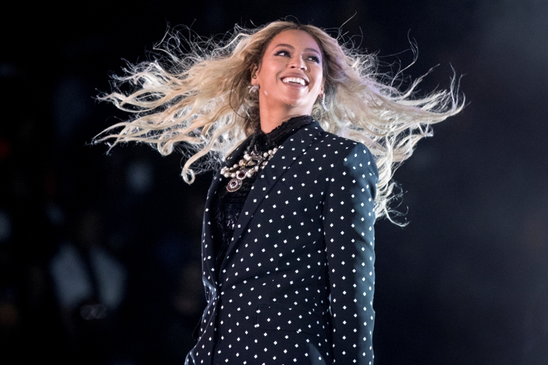 "FILE - In this Nov. 4, 2016 file photo, Beyonce performs at a Get Out the Vote concert for Democratic presidential candidate Hillary Clinton in Cleveland. The pop star is the leader of the 2017 Grammys with nine nominations, including bids for album of the year with ""Lemonade,"" and song and record of the year with ""Formation,"" announced Tuesday, Dec. 6. The singer, who already has 20 Grammys, is also the first artist to earn nominations in the pop, rock, R&B and rap categories in the same year. AP/Andrew Harnik, File"