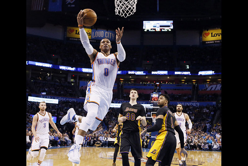 Oklahoma City Thunder guard Russell Westbrook takes an easy shot during the second quarter of an NBA game in Oklahoma City. AP