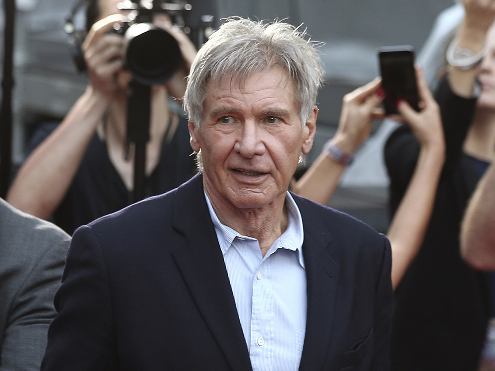 In this December 10, 2015 file photo, Harrison Ford greets fans during a Star Wars fan event in Sydney, Australia. Ford told an air traffic controller he was distracted and concerned about turbulence from another aircraft when he mistakenly landed his small plane on a taxiway at a Southern California airport in Feb. 2017. AP/Rob Griffith, File