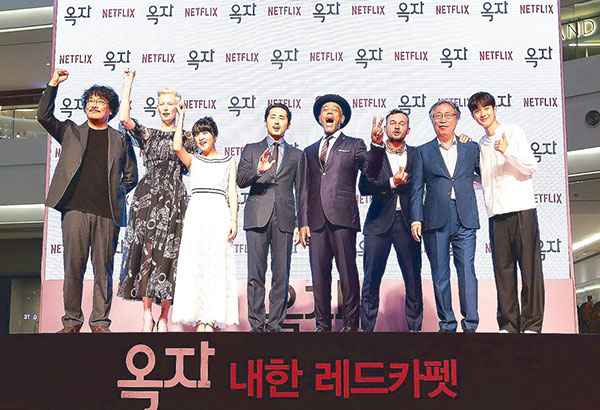 Director Bong Joon-Ho with the South Korean and Hollywood cast of his film Okja (from left) Tilda Swinton, Ahn Seo-Hyun, Steven Yeun, Giancarlo Esposito, Daniel Henshall, Byun Hee-Bong and Choi Woo-Shik during a red-carpet event in Seoul. Photos courtesy of Chung Sung-jun/Getty for Netflix