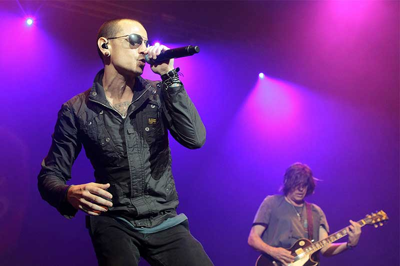 FILE - In this May 16, 2015 file photo, Chester Bennington, left, performs during the MMRBQ Music Festival 2015 at the Susquehanna Bank Center in Camden, N.J. The Los Angeles County coroner says Bennington, who sold millions of albums with a unique mix of rock, hip-hop and rap, has died in his home near Los Angeles. He was 41. Coroner spokesman Brian Elias says they are investigating Bennington's death as an apparent suicide but no additional details are available. Photo by Owen Sweeney/Invision/AP, File