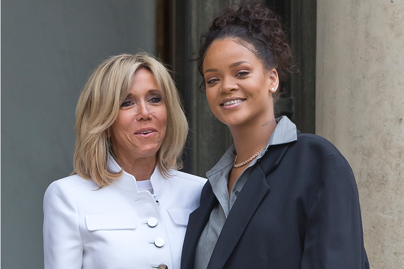Brigitte Macron, left, the wife of French President Emmanuel Macron welcomes singer Rihanna at the Elysee Palace to meet French President Emmanuel Macron in Paris, France, Wednesday, July 26, 2017. Global Ambassador for the Global Partnership for Education Rihanna meet French President Emmanuel Macron to discuss France's contributions to the Global Partnership for Education. AP/Michel Euler