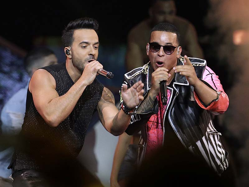 "In this April 27, 2017 file photo, singers Luis Fonsi, left and Daddy Yankee perform during the Latin Billboard Awards in Coral Gables, Fla. On Friday, Aug. 4, 2017, YouTube announced that the music video for the No. 1 hit song ""Despacito"" has become the most viewed clip on YouTube of all-time. AP/Lynne Sladky, File"